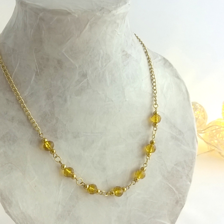Glass bead and gold chain necklace